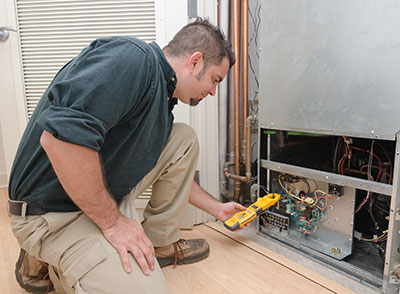 heater technician performing routine maintenance