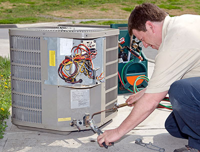 hvac technician installs heater repalcement